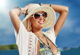 Beautiful happy woman enjoying freedom on a summer beach
