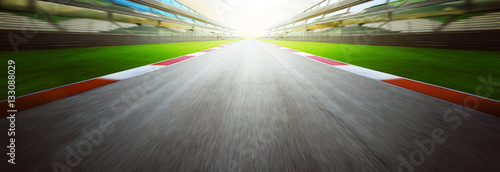 View of the infinity empty asphalt international race track, Motion blurred background . evening scene .