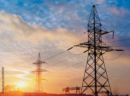silhouette of power lines in the factory and sunset background. Poster