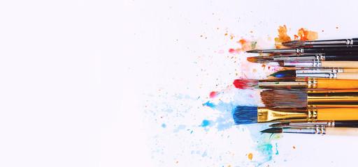 artistic brushes on wooden background © Mikhaylovskiy