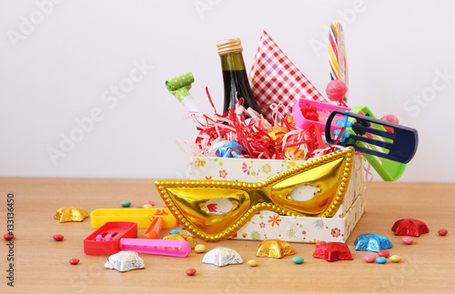 Mishloach manot - Jewish costum on Purim holiday on a wooden table