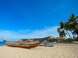 Catamaran on the White Sand Beach