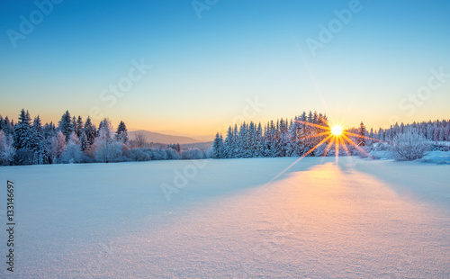 Majestic sunrise in the winter mountains landscape.