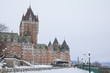 View of Frontenac Castel (Chateau de Frontenac, in French) in winter under the snow. The Château Frontenac is a grand hotel in Quebec City, Quebec, Canada, and a symbol of the city