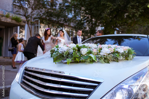 Beautifully decorated wedding car Poster