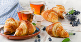 Fresh Croissants with Two Cups of Black Tea
