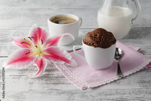 Poster Cup cake in teacup with coffee