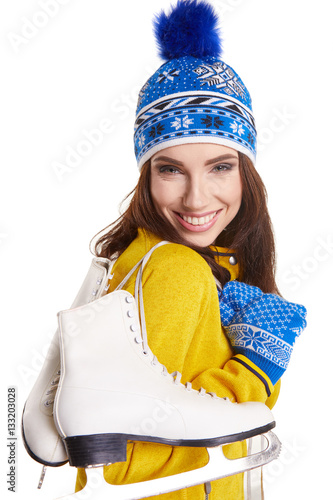 Pretty woman ice skating winter sport activity in white cap smil Poster