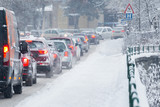 Traffic jam in the middle of winter. Snow calamity. - 133209489