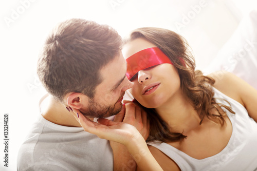 Poster Playful couple in bedroom