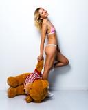 Sexy blonde girl in underwear with big stuffed animal