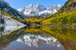 Autumn Mountain Lake - Autumn view of snow coated Maroon Bells and crystal clear Maroon Lake, Aspen, Colorado, USA.