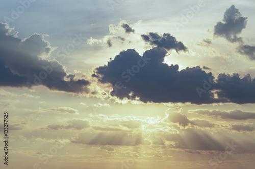 Poster Shade of sunlight behind dark cloud before sunset