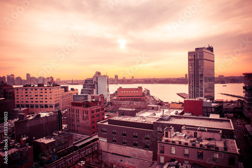 New York City sunset scene from the west side of Manhattan near the Meatpacking and Chelsea districts looking towards New Jersey with buildings and river in view Poster