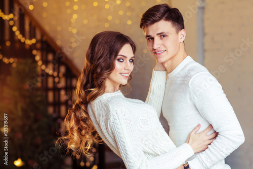 Poster Young couple cuddling