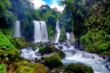 Beautiful waterfall in daylight, this is called Jenggala waterfall, located in Baturraden, Central Java, Indonesia