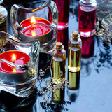 Spa concept: aromatic oil on the black glossy background