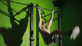 Shirtless man doing stomach exercises on a horizontal bar. CrossFit. workout