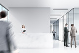 Two men in suits are talking in a corner of an office hall. There is a marble reception desk and a corridor in the background. 3d rendering. Mock up.