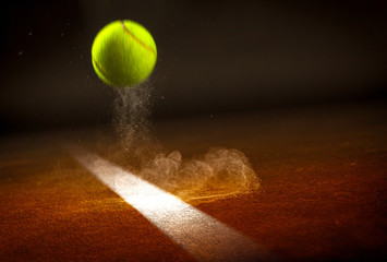 Tennis ball falling on the line