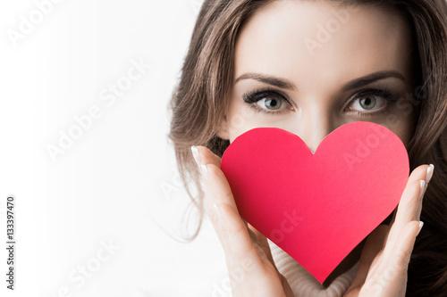 Girl holding paper heart Poster
