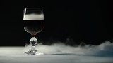 wine in glass on wooden smoky surface
