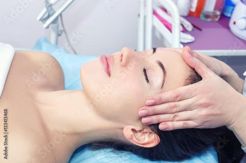 Poster Woman enjoying facial massage