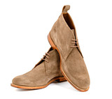 Mens almond suede boots isolated