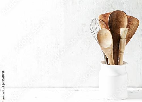 Poster Assorted cooking utensils in a ceramic dish