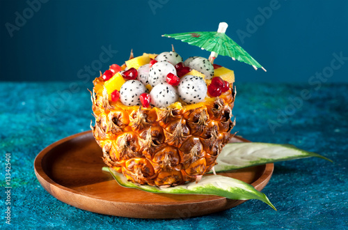 Poster Exotic fruit salad. Dragon fruit, pineapple and pomegranate