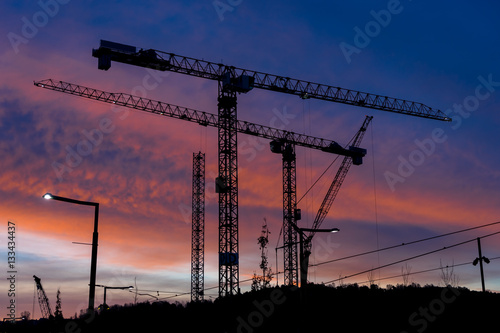Poster Industrial cranes building Oslo sunset background