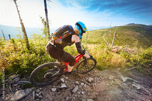 Deurstickers Fietsen Young woman,mountain biker riding downhill on MTB bike, single track in Europe, Poland