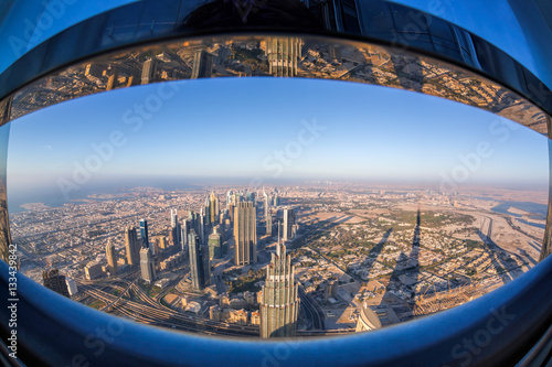 Poster Dubai skyline with futuristic architecture by fisheye, United Arab Emirates