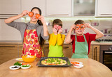 Three funny kids making the pizza