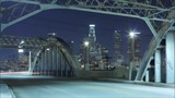 the View of Night City Bridge. the Bridge Ride Car With Headlights Included. Along the Road There Are Night Lights and Illuminate the Streets.