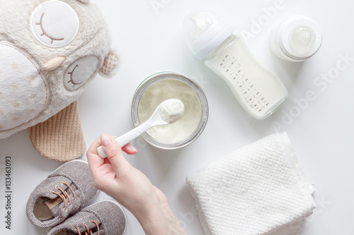 preparation of mixture baby feeding on white background top view
