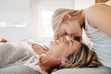 Loving mother and daughter in bedroom