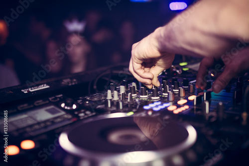 DJ plays music on his Pioneer deck in party