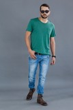 Man in green t-shirt and sunglasses