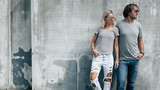 Couple in gray t-shirt over street wall