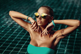 Vogue style fashion portrait of beautiful chic woman in water -