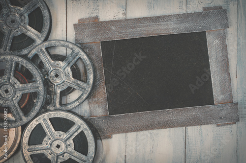 Reels of film and a black board Poster