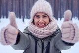 Close-up of delightful woman showing thumbs up to the camera