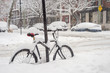 Bike covered with fresh snow in Montreal during snow storm (December 2016)