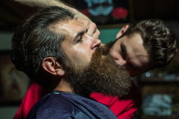 Handsome bearded man in barbershop