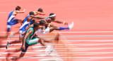 Jumping over hurdles, motion blur