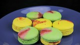 Colorful macaroon slowly rotate on the blue plate