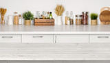 Fototapety Empty wooden table with bokeh image of kitchen bench interior