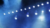 Lighting equipment on the stage. Smoke blue in the spotlight. The musical show, concert, performance.