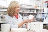 Mature Woman In Pottery Studio Casting Mug